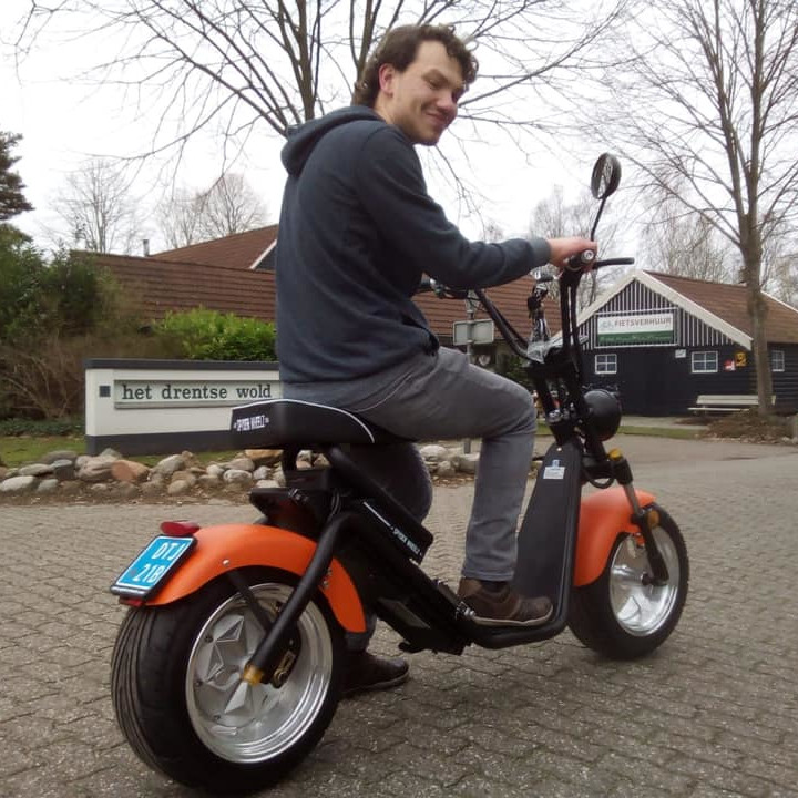 Martijn Famyfuerza riding a scooter at Holidaypark Het Drentse Wold