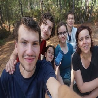 Group photo reflection in camera lens